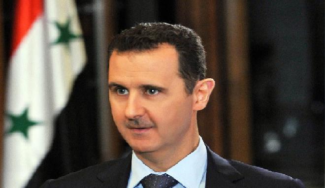 الاسد يصف دستور العراق بـ
