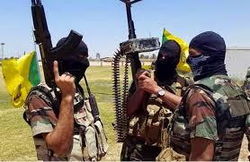 مسلحون من حزب الله يقتحمون مركز شرطة ببغداد ويطلقون سراح معتقليهم